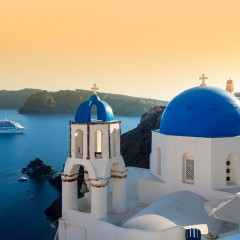 Santorini May Be Capping Tourist Numbers, If You're Traveling By Cruise